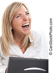 Woman with laptop happily laughing