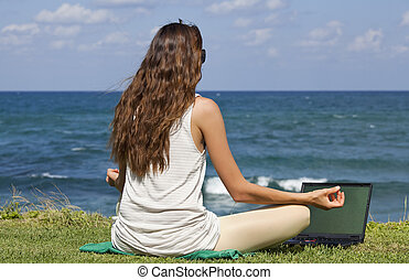 woman with laptop in yoga pose