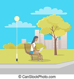 Woman with Laptop Sits on Bench in City Park