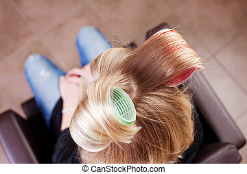 Woman with large curlers in her hair