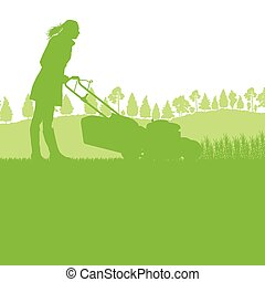 Woman with lawn mover cutting grass