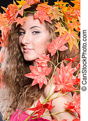 Woman with leaves in nature concept