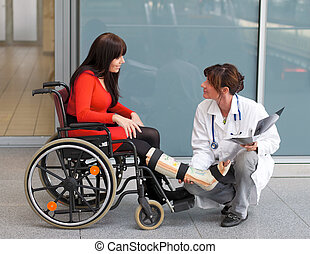 Woman with leg in plaster, doctor and chair