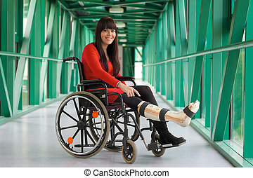 Woman with leg in plaster - Young woman with leg in plaster