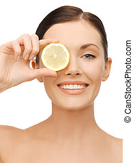 woman with lemon slice - bright picture of beautiful woman...