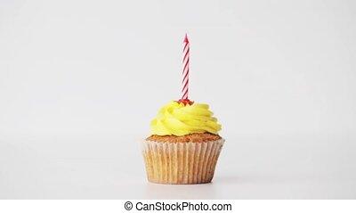 woman with lighting candle on birthday cupcake - holiday,...