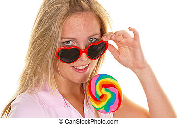 Woman with lollipop sucker
