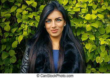 Woman with long black hair.
