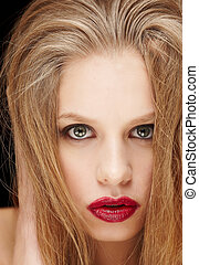 Woman with long blond hait and red lips.