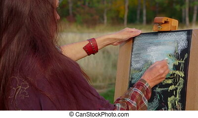 Woman With Long Brown Hair Drawing A Picture At Plein Air