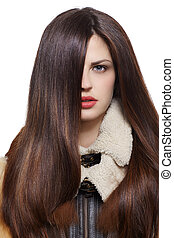Woman with long brown hairs