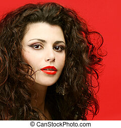 Woman with long curly hair - beauty salon model
