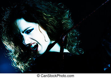 Woman with long curly hair in extasy