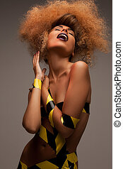 woman with long curly hair - beauty and glamour concept -...