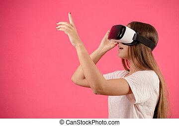 woman with long hair and vr glasses is rising her finger .a short in the dark