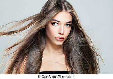 Woman with Long Healthy Hairstyle. Beautiful Model with Brown Hair and Cute Face. Beauty Salon Background