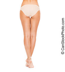 woman with long legs in cotton underwear - health and beauty...
