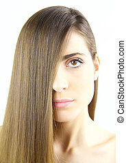 Woman with long silky brown hair and beautiful lips