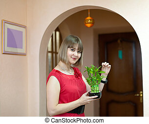 woman with lucky bamboo