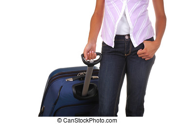 Woman with Luggage - Woman in jeans pulling suitcase...