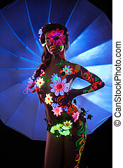 Woman with luminescent body art