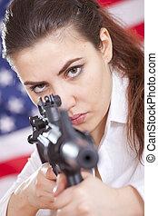 woman with machine gun aiming