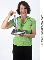 woman with mackerel on white background