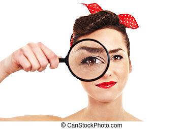 Woman with magnifier on white background