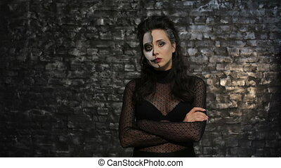 Woman with make-up skeleton posing