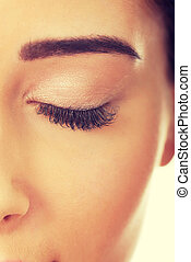 Beautiful woman with fresh makeup and eyes closed.