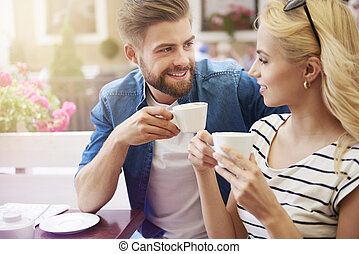 Woman with man drinking coffee together