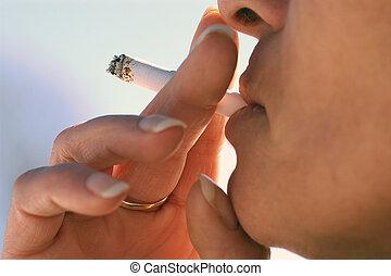 smoking - woman with manicure smoking.