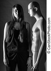 Woman with mannequin in the dark