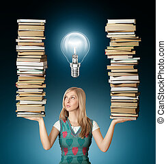 woman with many books in her hands and bulb