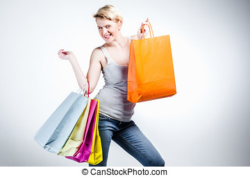 Woman with many shopping bags