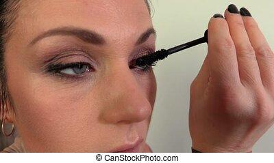 Woman with mascara closeup