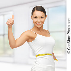 woman with measuring tape - picture of beautiful woman with...