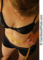 Woman with measuring tape
