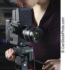 Woman with medium format camera - Woman photographer working...
