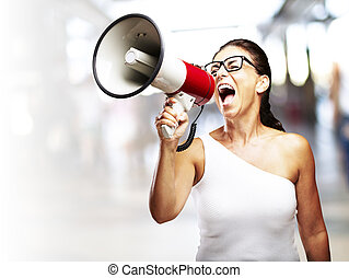woman with megaphone - portrait of middle aged woman...