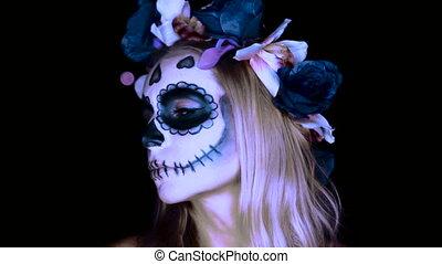 Woman with Mexican sugar skull makeup - Closeup face of...