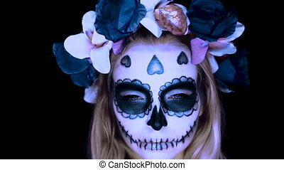 Woman with Mexican sugar skull makeup - Closeup face of...