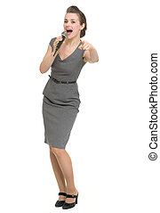 Woman with microphone pointing on you isolated