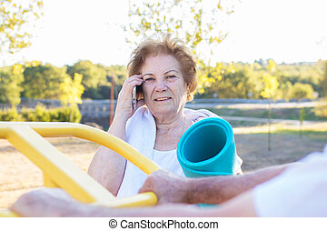 woman with mobile phone doing outdoor sports
