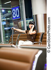 Woman with mobile phone in the airport