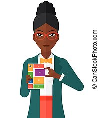 Woman with modular phone. - An african-american woman with...
