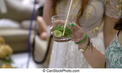 Woman with mojito cocktail at the party
