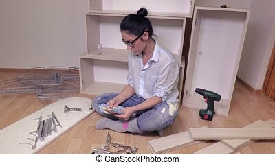 Woman with money near furniture details