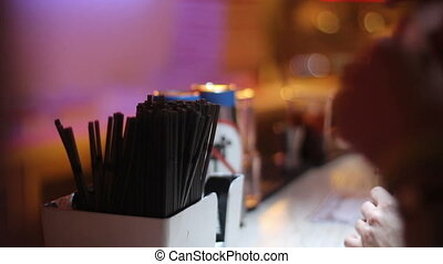 Woman with money on bar waiting for drink