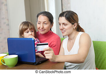 Woman with mother and child buying online